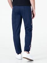 Image sur Pantalon de jogging à rayures avec logo