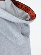 Bild von Hoodie mit Schriftzug in der Kapuze