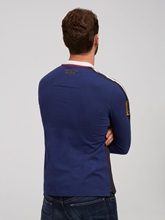 Bild von Polo-Shirt in Colourblock-Optik mit Stickerei