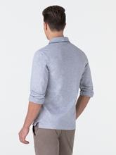 Bild von Polo-Shirt in melierter Optik mit Streifen