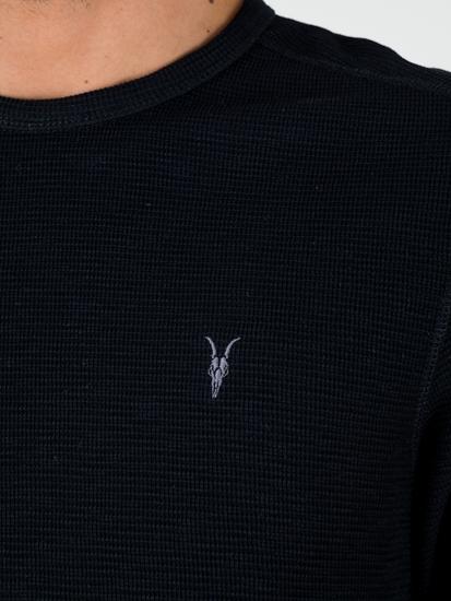 Bild von Shirt mit Struktur und Logo
