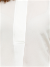 Bild von Blusenshirt aus Material-Mix