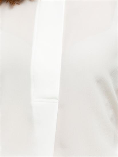 Image sur Blusenshirt aus Material-Mix