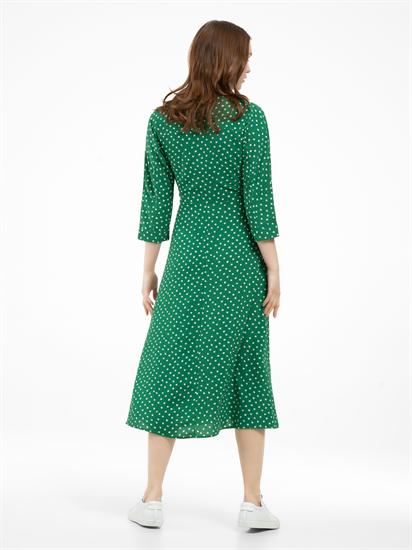 Bild von Kleid in Wickel-Optik mit Punkten