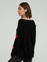 Image sur Pullover oversized et coeurs