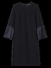 Bild von Kleid mit Seidenbesatz