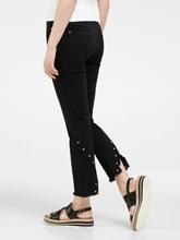 Bild von Jeans mit Nieten und Fransen
