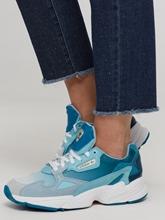 Bild von Jeans mit Strasssteinen und offenem Saum