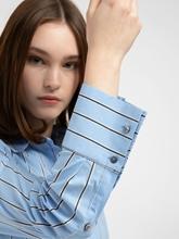 Bild von Bluse mit Streifen und Schösschen