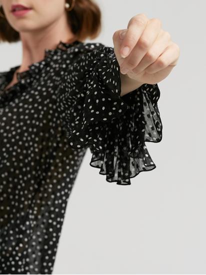 Bild von Bluse mit Punkten und Rüschen