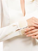 Bild von Blusenshirt mit Perlen am Ärmel