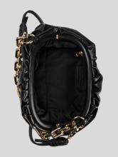 Bild von Handtasche mit Goldkette
